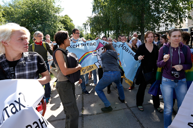 Opponents of the gay pride march attempted to disrupt by tearing down banners.