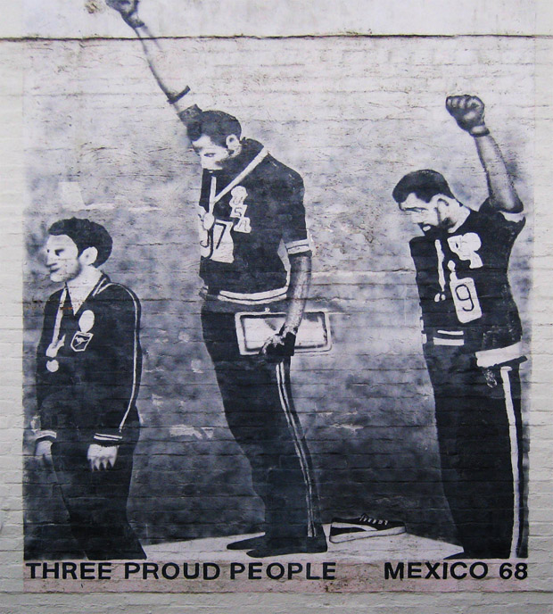 Tommie Smith, John Carlos and Peter Norman showing solidarity for the civil rights movement at the Mexico City Olympics in 1968 (Image: Newtown graffiti/Wikimedia Commons)
