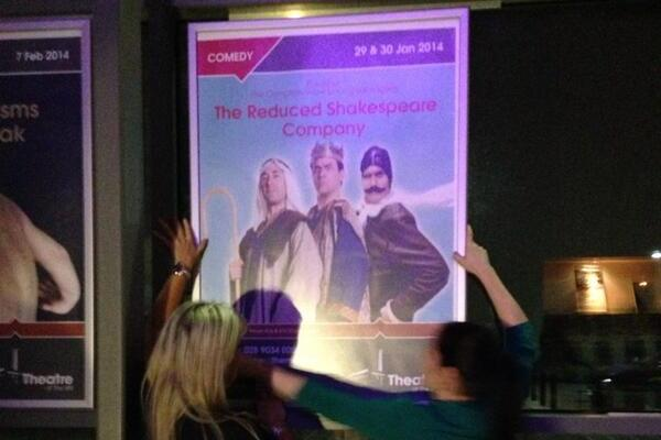 Staff at Newtownabbey's Theatre on the Mill return promotional posters to hoardings after the local council overturned a ban on the Reduced Shakespeare Company's The Bible (Abridged). Image Conor Macauley/Twitter