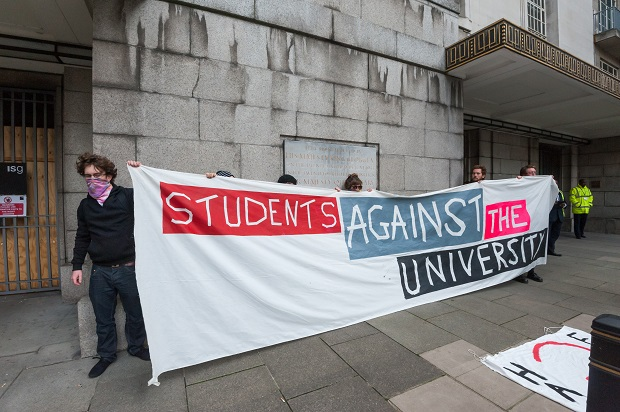 Students defy the protest ban imposed by the University of London to speak out against the privatisation of university support services. (Photo: Peter Marshall/Demotix)