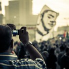An Egyptian man takes a photo of a large anti-Morsi protest in Tahrir Square, Egypt (Photo: Phil Gribbon/Alamy)