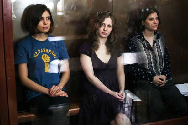 Feminist punk group Pussy Riot members, Nadezhda Tolokonnikova (left), Maria Alekhina (centre) and Ekaterina Samutsevich (right) sit in a glass cage at a court room in Moscow. Maria Pleshkova | Demotix
