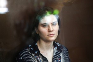 Pussy Riot member Ekaterina Samutsevich sits in a glass cage at a court room in Moscow, August 2012. Maria Pleshkova | Demotix