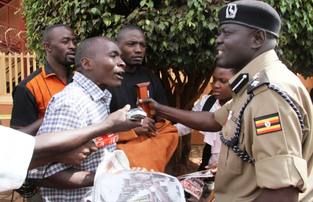 Police and protesters clash at the offices of the Daily Monitor, Kampala. Picture Isaac Kasamani/Demotix