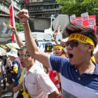 Activists and civic groups march in Taipei in protest against the Want Want China Times Group's planned acquisition of China Network Systems's cable TV services in Sept 2012. (Photo: Craig Ferguson / Demotix)
