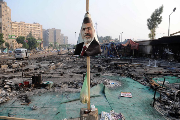 Egypt faced a new phase of uncertainty after the bloodiest day since its Arab Spring began, with nearly 300 people reported killed and thousands injured as police smashed two protest camps of supporters of the deposed Islamist president. (Photo: Nameer Galal / Demotix)