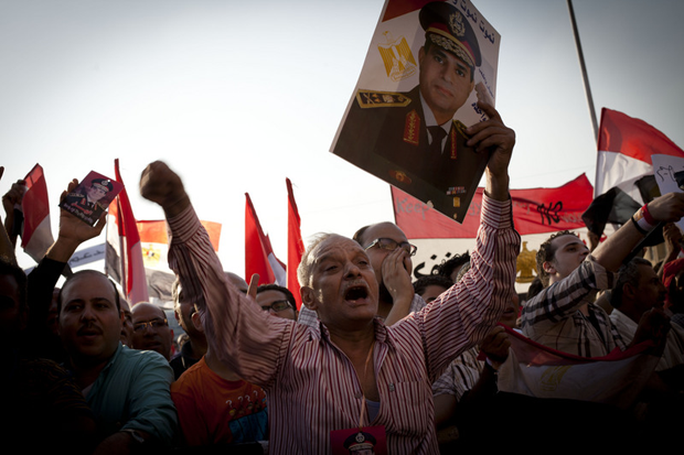 A protester holds a portrait of General Abdel Fattah al-Sisi during protests in July. (Shawkan / Demotix)