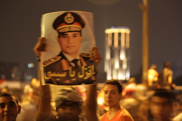 "Egyptians gathered on the in Corniche near Qasr Nil Bridge in July 2013 to celebrate news of the announcement by the Egyptian Army Chief General el Sisi, that President Morsi had been removed from power in ""response to the will of the people."" (Photo: Sharron Ward / Demotix)"