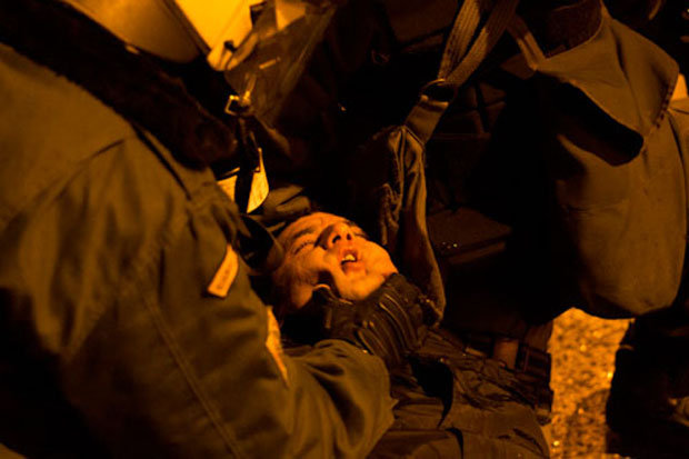 Unconscious protester dragged by police during an anti-fascist demonstration (Image: Nikolas Georgiou)