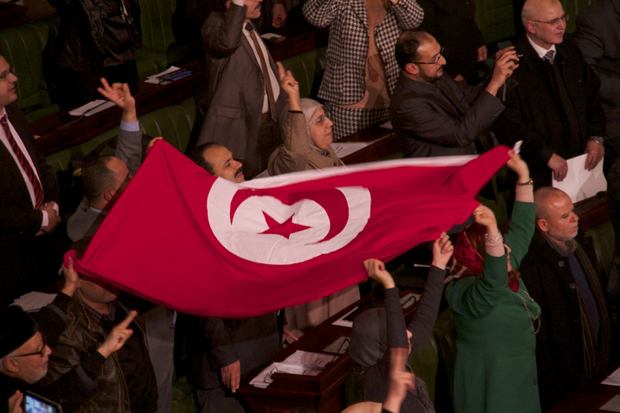 After decades of dictatorship and two years of arguments and compromises, Tunisians finally have a new constitution laying the foundations for a new democracy. Deputies celebrating the ratification of the new constitution for Tunisia. (Photo: Mohamed Krit / Demotix)