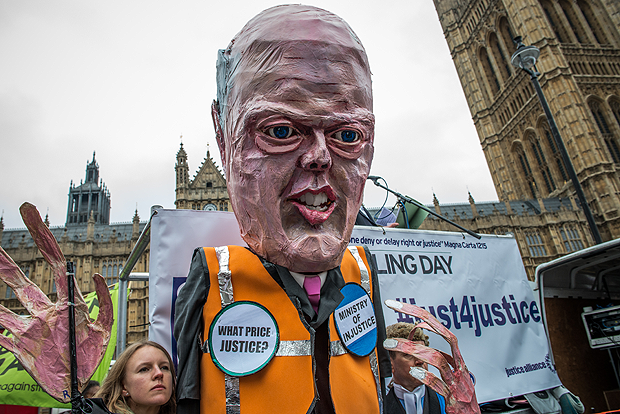 Activists marched with an effigy of justice minister Chris Grayling in March to protest legal aid cuts. (Photo: Velar Grant / Demotix)