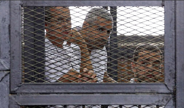 Three Al Jazeera journalists were among those sentenced to prison on terrorism charges.