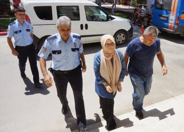 Büşra Erdal, mentioned in the text, surrendered in Manisa and taken to police hq in handcuffs.