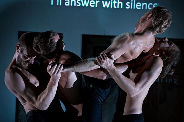 Kiryl Kanstantsinau, Siarhei Kvachonak, Andrei Urazau and Pavel Haradnitski performing in Burning Doors. (Photo by Nicolai Khalezin for Belarus Free Theatre)