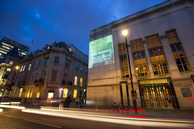 OCT 2016: LONDON: Belarus Free Theatre project Ai Weiwei's symbol of freedom of expression onto five iconic buildings across London (10 Oct 2016) to highlight the case of Oleg Sentsov, the popular film director and pro-Ukrainian activist serving a 20-year prison sentence in Russia for a crime he did not commit. ( Pictures by Graeme Robertson )