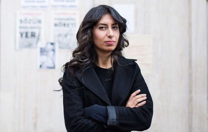 Turkish journalist Canan Coskun stands with her arms folded