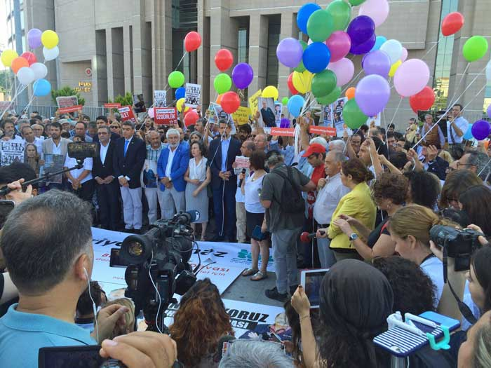 People gather in support of the Cumhuriyet defendants as the trial got underway.