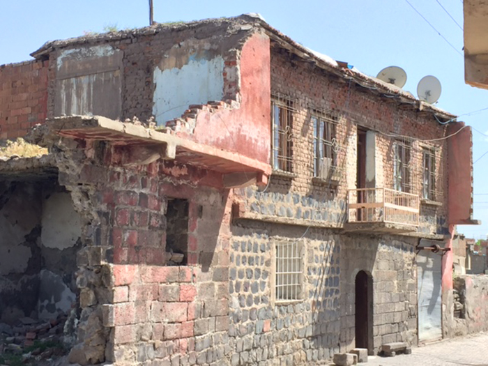 Historic buildings were destroyed in order to build housing for the displaced and the area quickly became a slum. In a short time, some of the new housing became unhealthy and unstable.