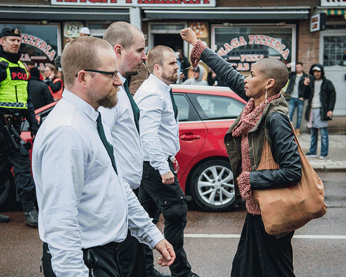 Tess Asplund faces protesters from the Nordic Resistance Movement in Borlänge, Sweden, in May 2016