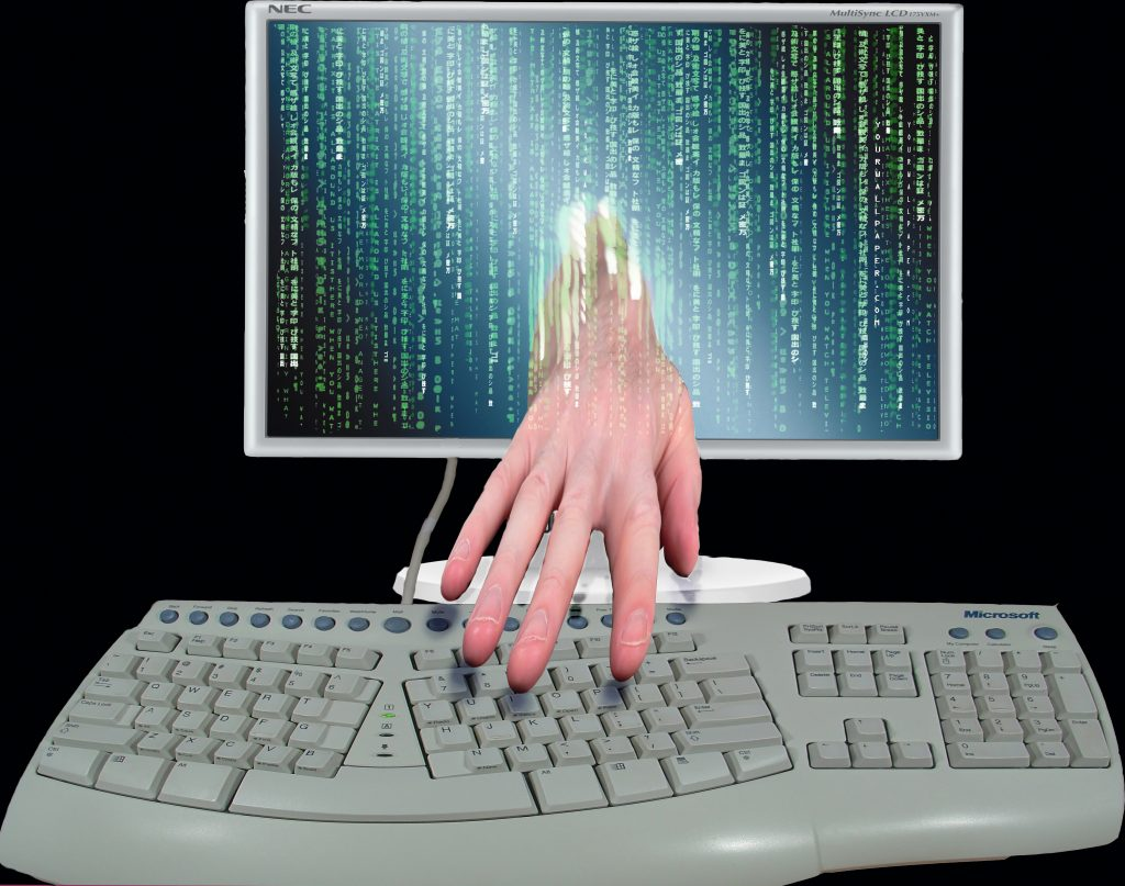 Hand coming out of computer, symbolising hackers, Don Hankins/Flickr