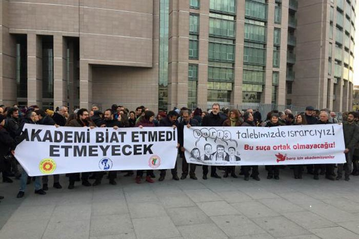 Protesters mark the opening of trials against Turkish academics.