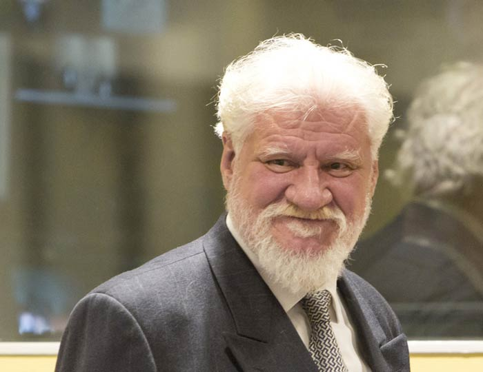 Journalists who referred to Slobodan Praljak, seen here in 2013, and his co-defendants as war criminals after their conviction have been targeted by parties who think the men are heroes. (Photo: UN International Criminal Tribunal for the former Yugoslavia)