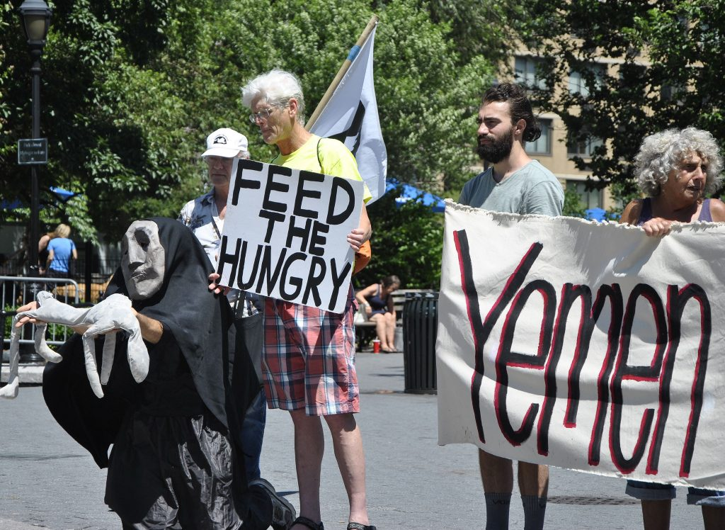 Members of the Catholic Worker movement take part in a vigil in Union Square Park, New York, for the people of Yemen, Felton Davis/Flickr