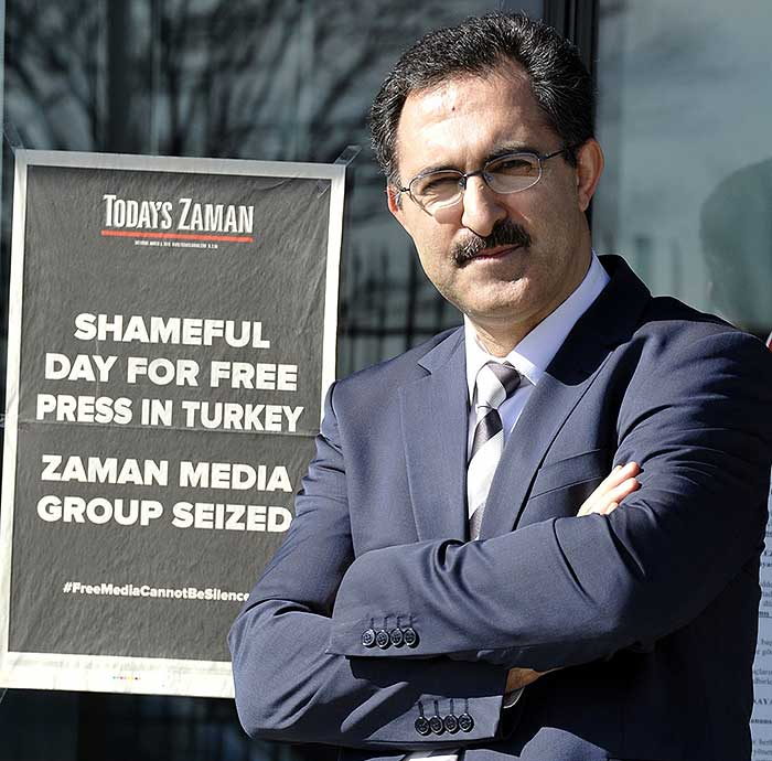 Abdullah Bozkurt, pictured with the last issue of the Turkish newspaper Today's Zaman (courtesy).