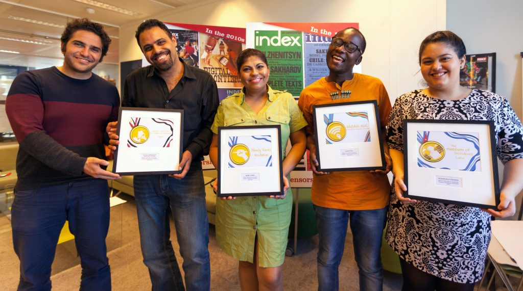 From right: Human rights defenders Mohamed Sameh and Ahmad Abdallah of 2018 Freedom of Expression Campaigning Award-winning Egypt Commission on Rights and Freedoms; 2018 Freedom of Expression Journalism Award-winning Honduran investigative journalist Wendy Funes; Congolese digital activist Guy Muyembe of 2018 Freedom of Expression Digital Activism Award-winning Habari RDC; Perla Hinojosa, Fellowship and Advocacy Officer at Index on Censorship, holds the 2018 Freedom of Expression Arts Award for Cuban arts collective Museum of Dissidence, who could not attend the Freedom of Expression Awards. (Photo: Index on Censorship)