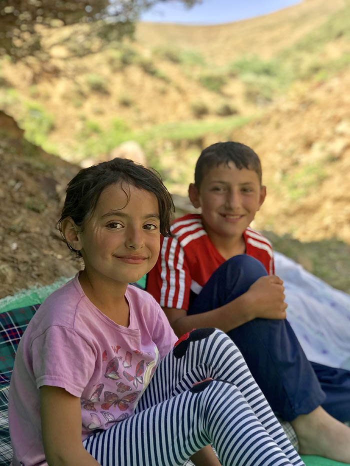 İdris Sayılgan's eight-year-old sister Hivda and 12-year-old Yunus. The family guides the cattle to the pasture. (Credit: Mezopotamya Agency)