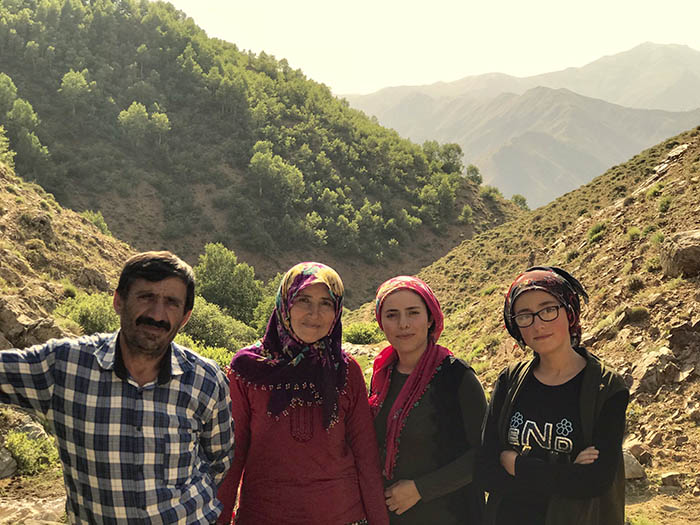 İdris Sayılgan's father Ramazan, mother Sebiha and sisters Tuğba and İrem pose in the meadow where the family comes the summers to breed their cattle (Credit: Mezopotamya Agency)