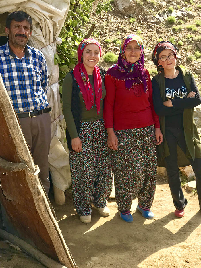 İdris Sayılgan's father Ramazan, mother Sebiha and sisters Tuğba and İrem pose next to the tent where the family stays. (Credit: Mezopotamya Agency)