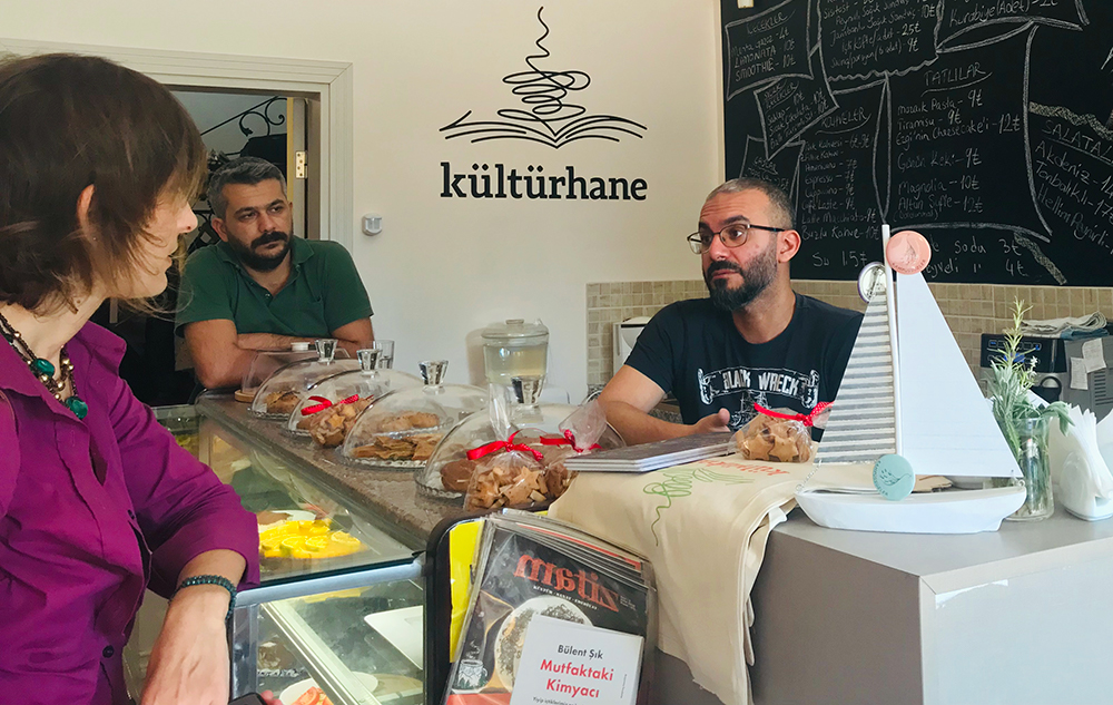 Deniz Altınay, a dismissed Academic for Peace and one of the founders of Kültürhane, works in the coffee area.