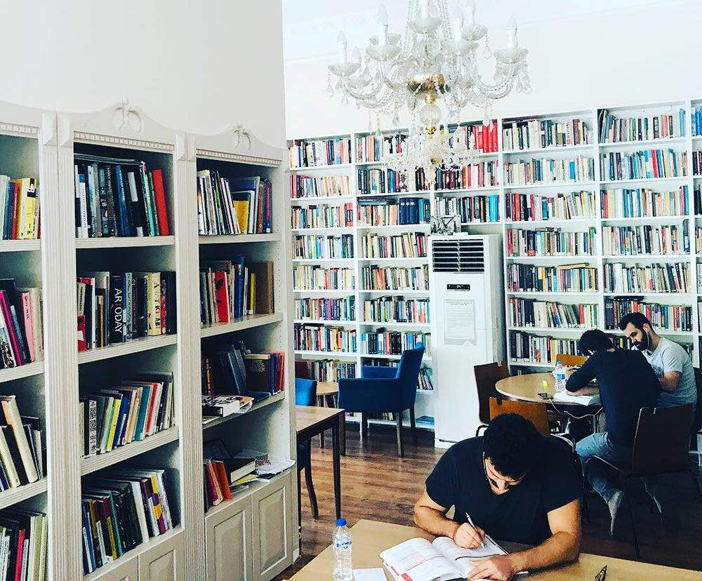 Students work in the Kültürhane library. A modest fee is charged for using the space, which includes tea or Turkish coffee.