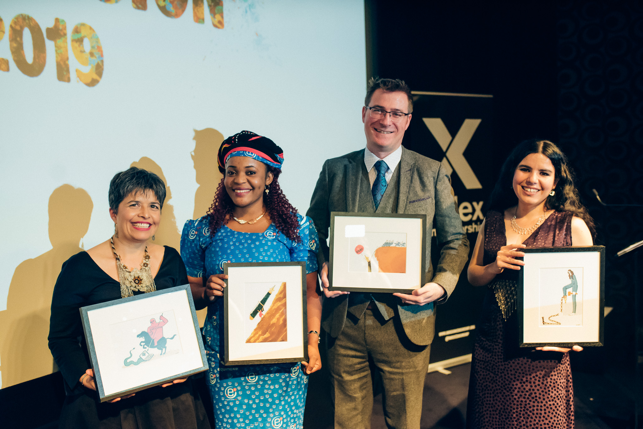 The 2019 Freedom of Expression Awards Fellows (from left): Carolina Botero Cabrera, executive director of digital activism award-winning Fundación Karisma; Journalism award-winning journalist Mimi Mefo; Terry Anderson, deputy executive director of campaigning award-winning Cartoonist Rights Network International; Arts award-winning Zehra Doğan. (Photo: Elina Kansikas for Index on Censorship)