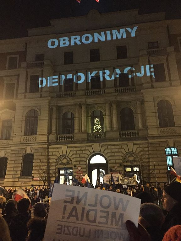 """A demonstration against limiting of freedom of the press, in Krakow, Poland, December 2016. The sign """"Wolne media! Wolni ludzie"""" translates as """"Free media! Free people"""". Credit: Joanna Wysocka Panasiewicz"""