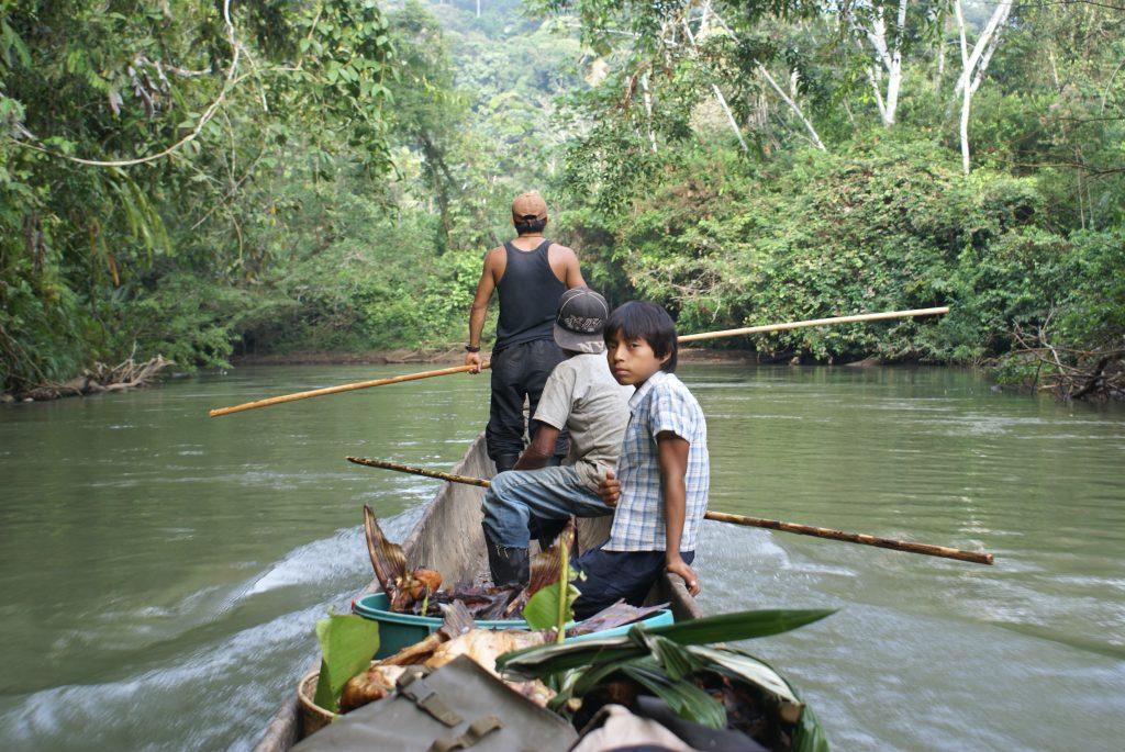 Sarayaku people on boat
